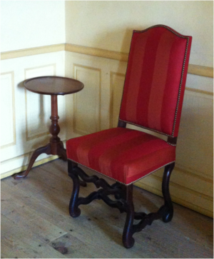 "An ""English"" candlestand coexists with a French os de mouton side chair in the reconstructed commissaire ordonnateur's house in Louisbourg, Parks Canada"