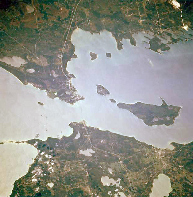 A north-facing aerial photograph of the Straits of Mackinac. Image Science and Analysis Laboratory, NASA. 1994. Wikimedia Commons